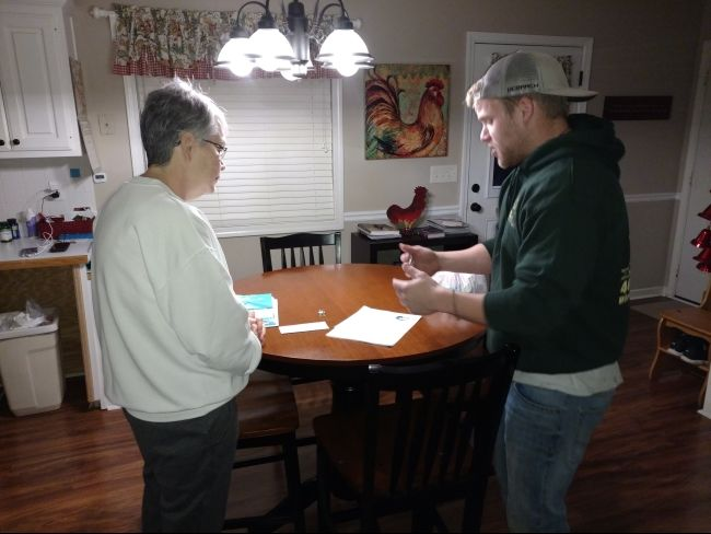 Contractor Speaking to Property Owner